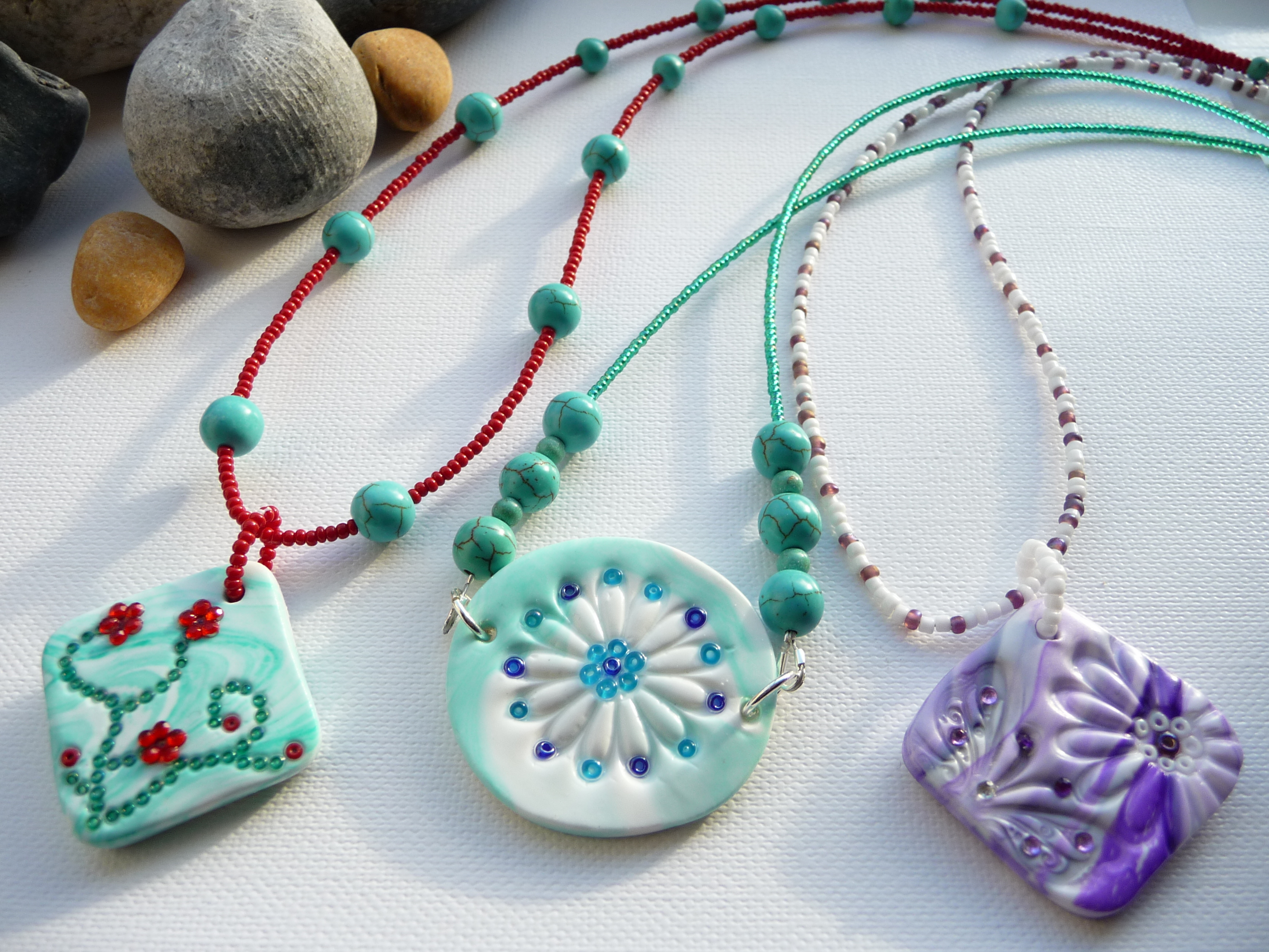 A selection of handmade polymer clay pendant on beaded necklaces 2592 in mothers day showcase handmade audiocablefo