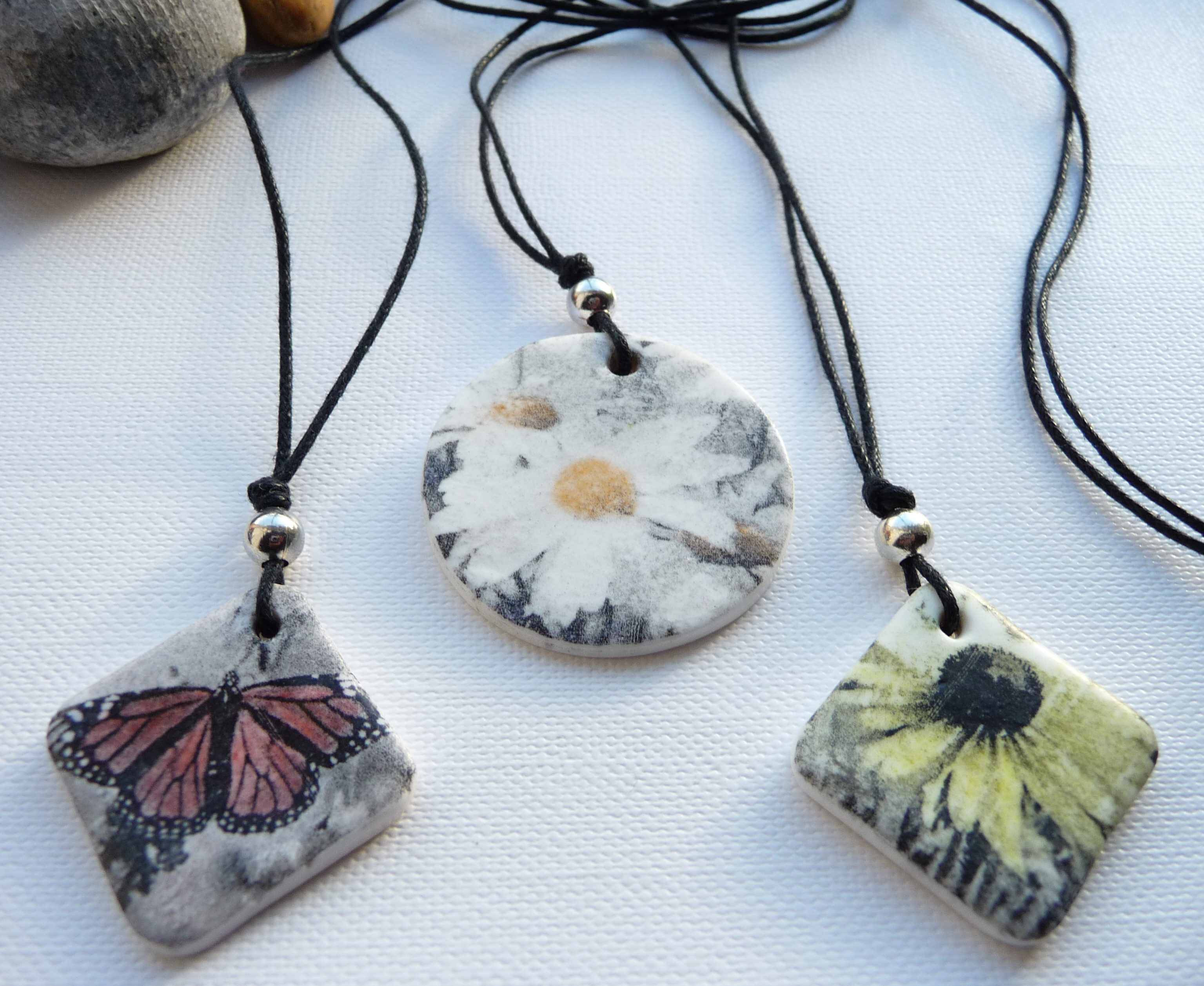A selection of handmade polymer clay printed pendants on waxed cord 2514 in mothers day showcase handmade audiocablefo